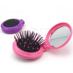Mirror with comb
